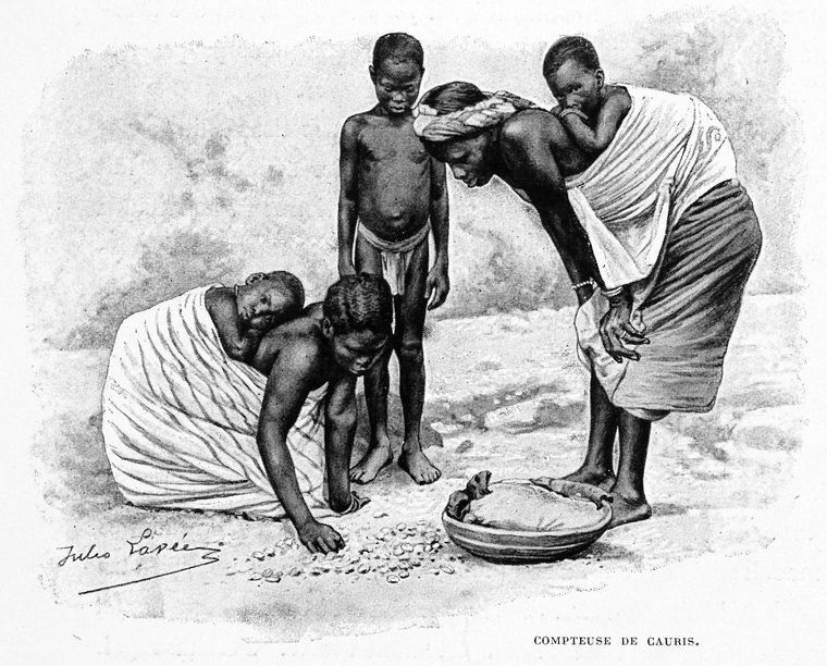 1895 illustration of African women counting cowries.