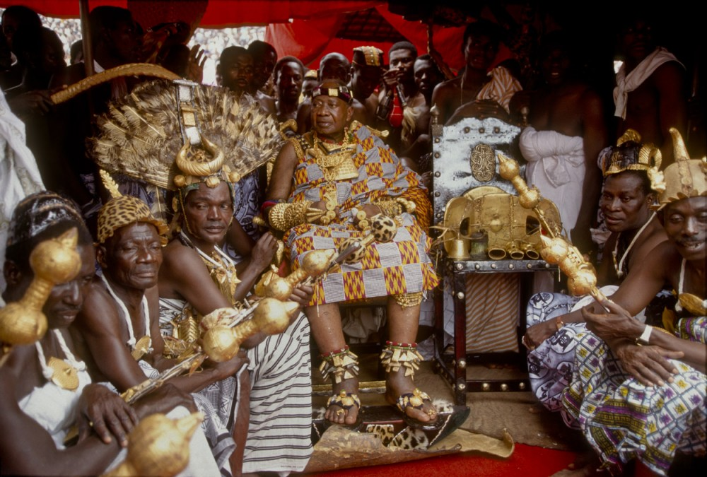 Asantehene Otumfuo Opoku Ware II (r. 1970 - 1999) sits next to the Ashanti golden stool.