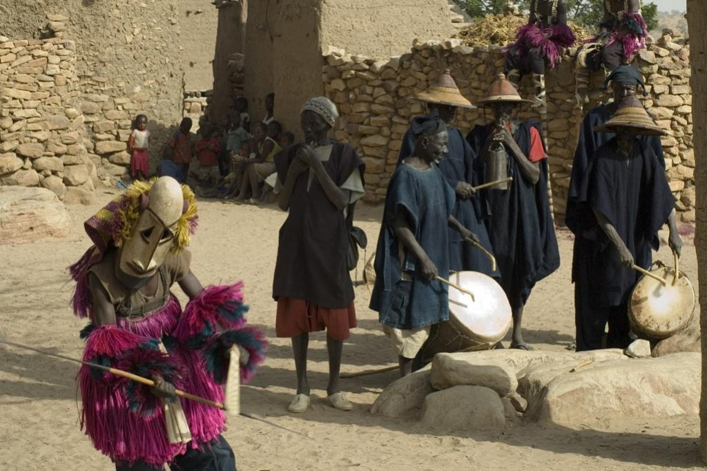 Masked performance accompanied by Dogon drummers