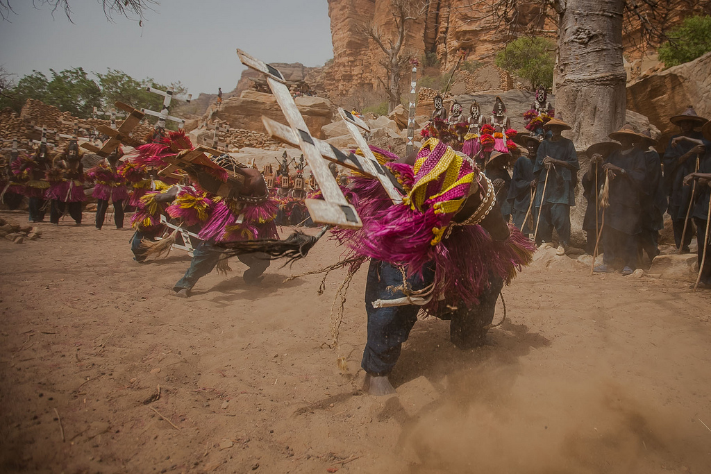 Dogon dancer of the Kanaga mask sweeps close to the ground