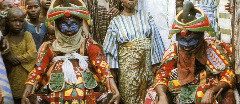 Egbado (Yewa) Gelede Society Daytime Masquerades Resting before Performance,Yoruba, Idahin Town, Ketu Region, Nigeria, 1971.