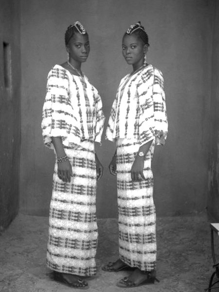 """West African Double Portraiture or """"Twin Images"""": Tijani Sitou. Two women posing as if they were twins, 1976"""