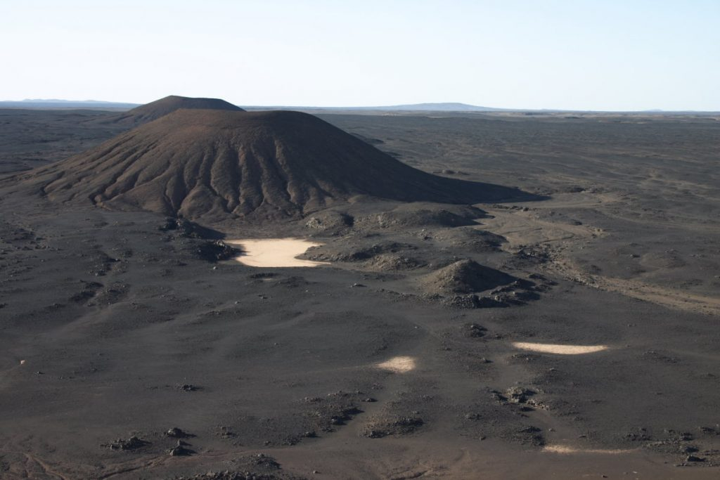The Lybian black desert, a volcanic landscape in the Sahara.