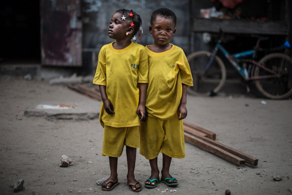 """Series: """"The Twins Of Koumassi"""". Photography of two four year old twins, a boy and a girl."""