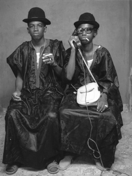 """West African Double Portraiture or """"Twin Images"""": Tijani Sitou. Two men posing as if they were twins, 1985"""