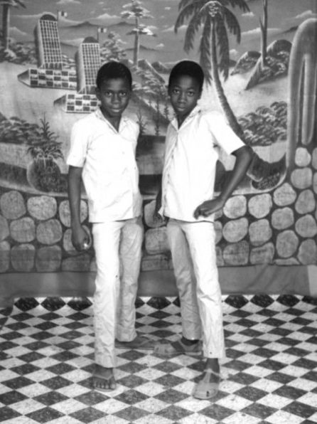 """West African Double Portraiture or """"Twin Images"""": Ibrahim Sanlé Sory. Two boys posing as if they were twins, 1974"""