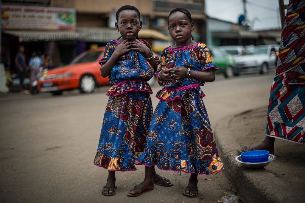 """Series: """"The Twins Of Koumassi"""". Photography of two four year old twin girls."""
