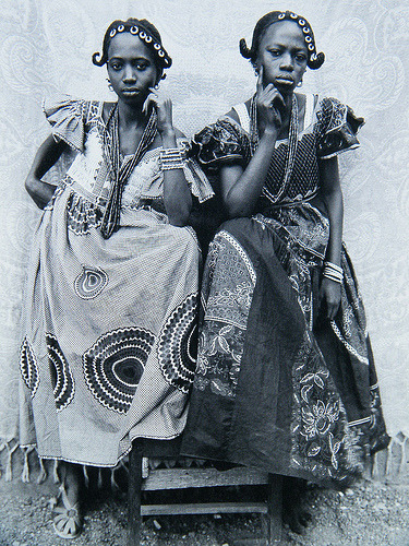"""West African Double Portraiture or """"Twin Images"""": Seydou Keita. Two young women posing as if they were twins."""
