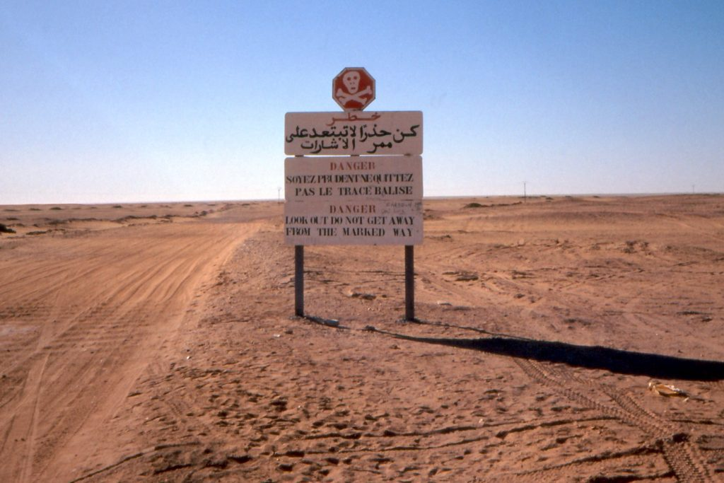 Danger sign at the entrance of the Tanezrouft, a harsh region of the Sahara, Mali.