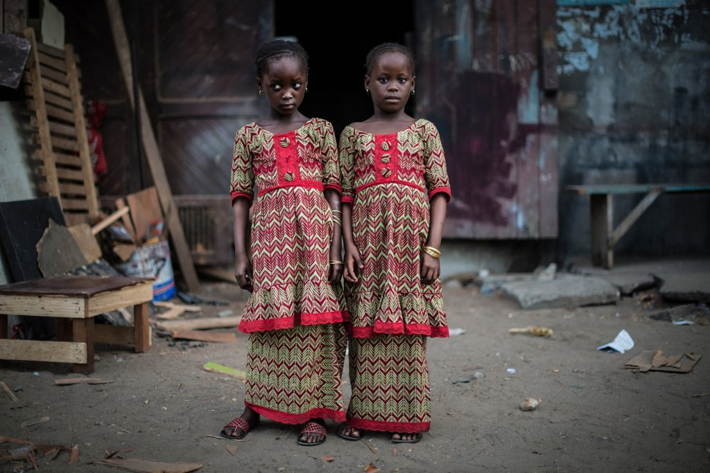 "Series: ""The Twins Of Koumassi"". Photography of two seven year old twin girls."