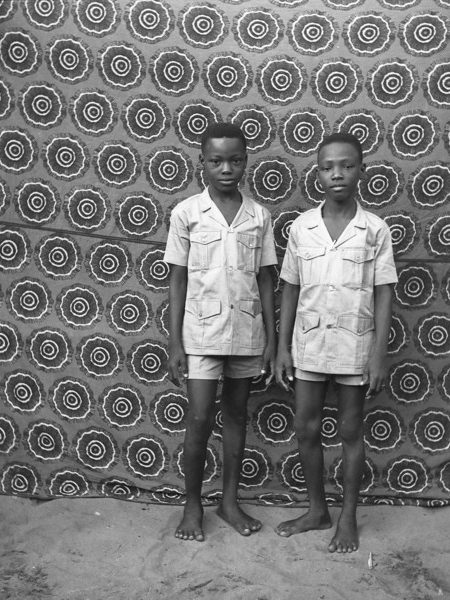 """West African Double Portraiture or """"Twin Images"""": François Montcho Ahehehinnou. Two brothers posing as if they were twins."""
