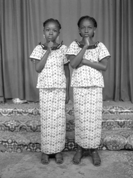"""West African Double Portraiture or """"Twin Images"""": Norom Japhet. Two girls posing as if they were twins, 1977."""