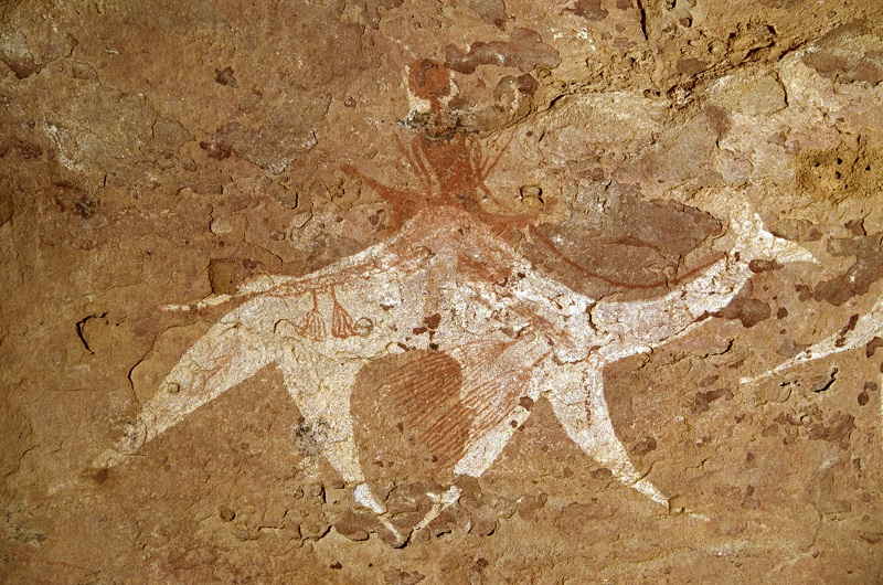Rock art of a camel and rider with saddle trappings in the Sahara desert of Chad
