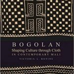 """Cover of the book """"Bogolan: Shaping Culture through Cloth in Contemporary Mali"""" by Victoria Rovine, featuring a piece of traditional mudcloth."""