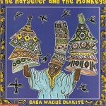 """Cover of the children's book """"The Hatseller and the Monkeys"""" by Baba Wagué Diakité, featuring a ceramic illustration of a West African hatseller."""