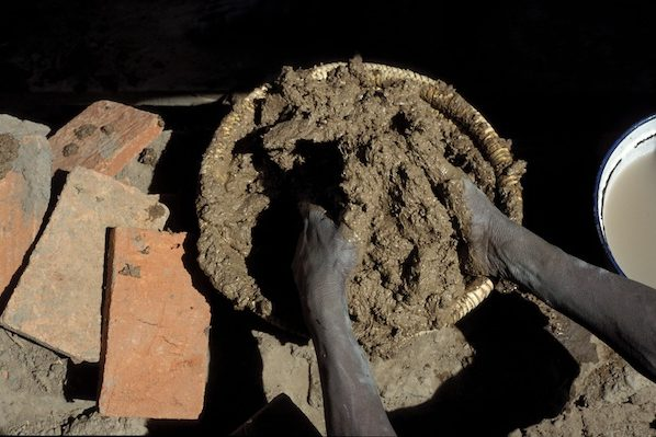 Annual plastering of the Great Mosque of Djenné in Mali. Photography of the master mason preparing the mud needed for the re-plastering.