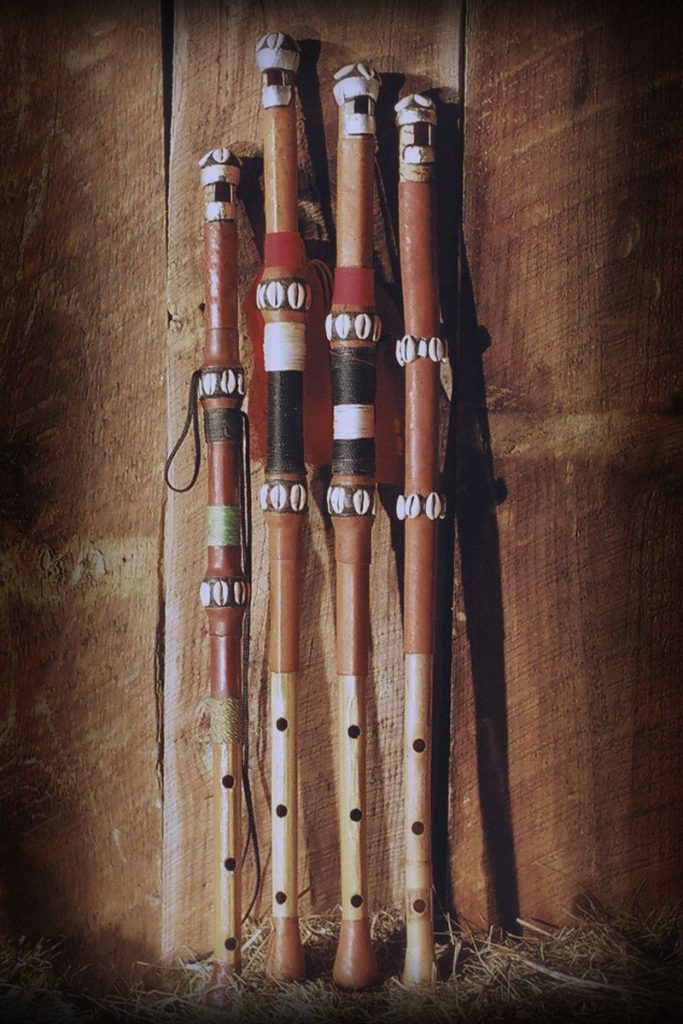 Photograph of several Fula tambins or flutes, West African wind instruments.