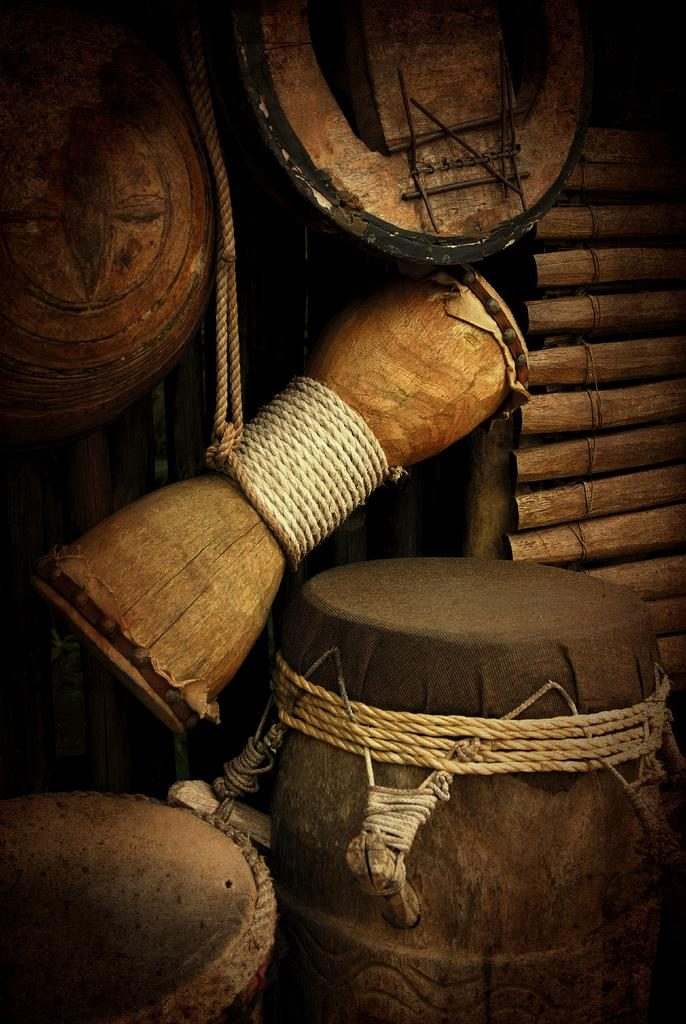 Photograph of West African percussive instruments: balafon, djembé and other drums.